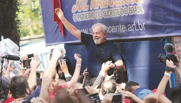 Former Brazilian president Luiz Inacio Lula da Silva is carried by supporters in front of the metall