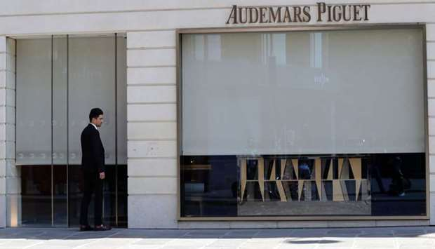 A man stands outside the the Swiss watchmaker Audemars Piguet shop in Paris following a robbery