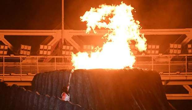 Former Indonesian athlete Susi Susanti lights the cauldron during the opening ceremony of the 2018 A