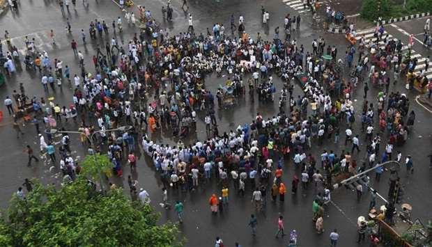 Bangladeshi students block a road during a student protest in Dhaka following the deaths of two coll