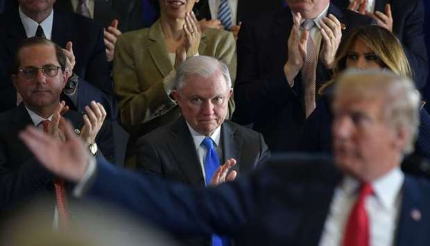 Attorney General Jeff Sessions (C) and First Lady Melania Trump (R) applaud as US President Donald T
