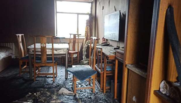 A view of a room after a fire at a hotel in Harbin