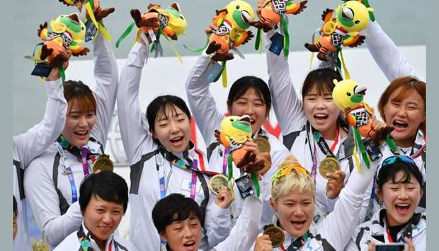 Members of the Unified Korea team celebrate with their bronze medals