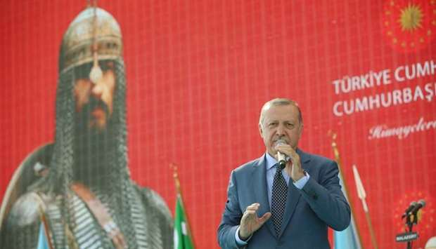 Turkish President Tayyip Erdogan makes a speech during a ceremony in the eastern city of Mus, Turkey