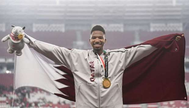 Abderrahman Samba celebrates during the victory ceremony for the men's 400m hurdles.