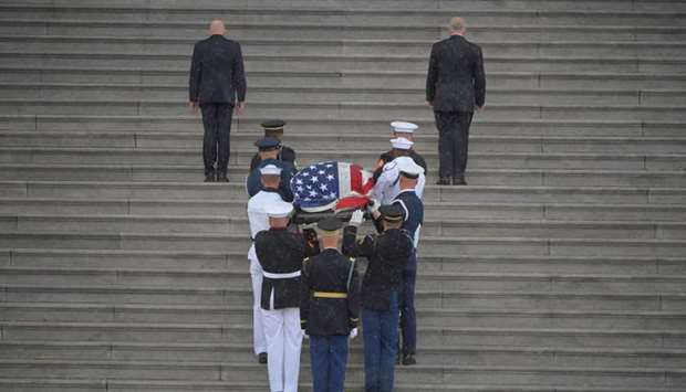 The casket of U.S. Senator John McCain is carried up the steps of the US Capitol