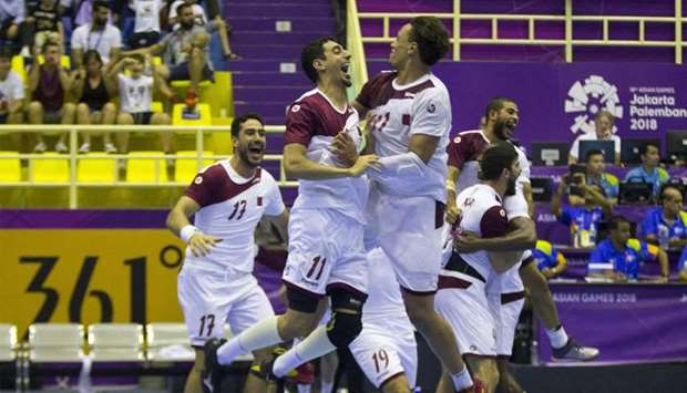 Qatar's team celebrate winning the men's handball match between Qatar and Bahrain at Asian Games in