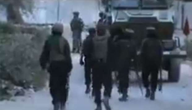 Soldiers patrolling the street in Shopian