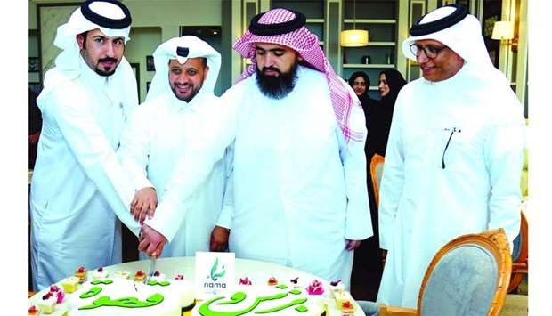 Al-Mohannadi and other dignitaries cut the ceremonial cake to launch the 'Business and Coffee' proje