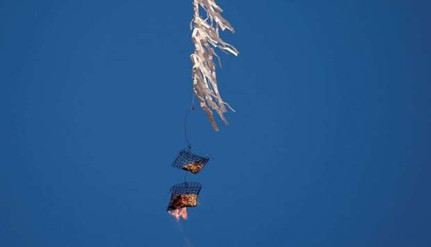 A kite loaded with flammable material is flown by Palestinians to be thrown at the Israeli side, dur