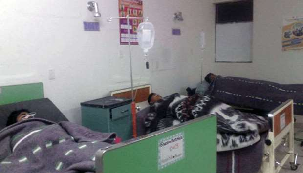 (file picture) People being treated for food poisoning at a hospital in Peru