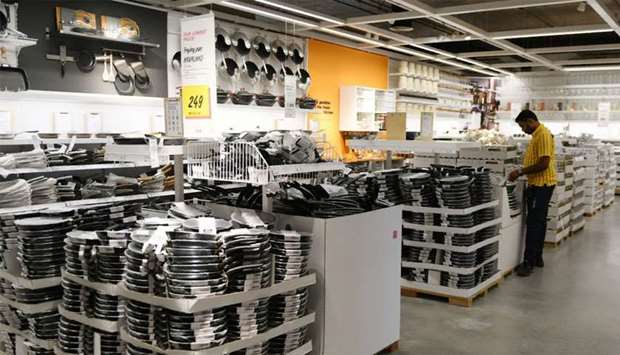 An Indian worker arranges pans at the kitcheware section of the new IKEA store in Hyderabad
