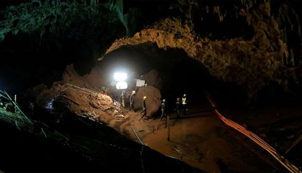 Rescue workers follow 12 soccer players and their coach out of Tham Luang cave complex in the northe