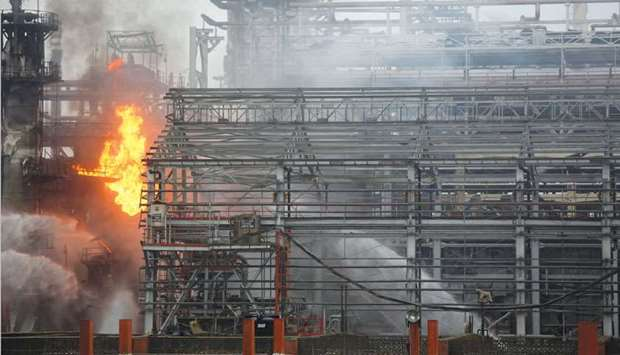 Smoke billows from the Bharat Petroleum Chemical Limited (BPCL) refinery after a fire broke out in t