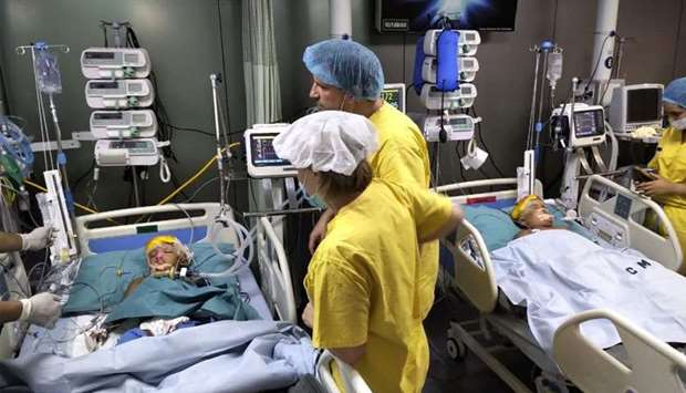 Bangladeshi twins who were joined at the head were recovering after Hungarian surgeons performed a m