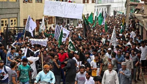 Kashmiris shout pro-freedom slogans during a protest in Srinagar.