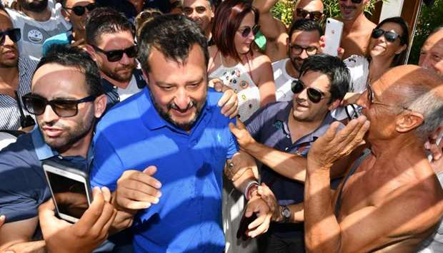 Italy's Interior minister and deputy Prime Minister Matteo Salvini looks on as he surrounded by supp
