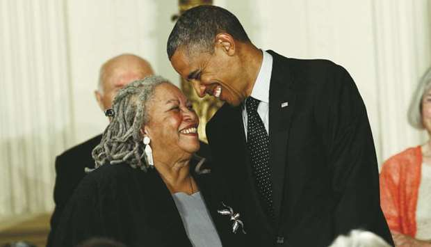 Novelist Toni Morrison smiles with US President Barack Obama