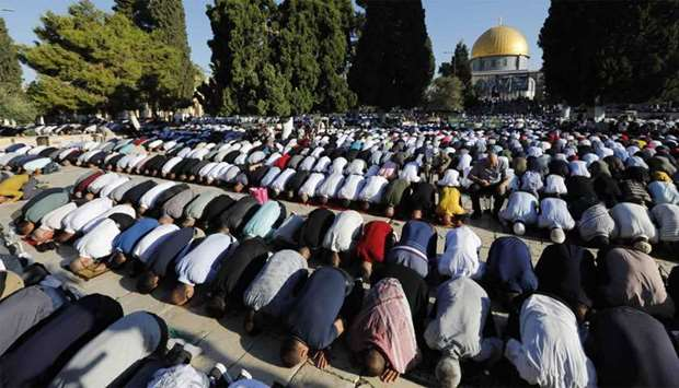 Palestinian worshippers perform the Eid al Adha morning prayers at the Al-Aqsa Mosque compound in th