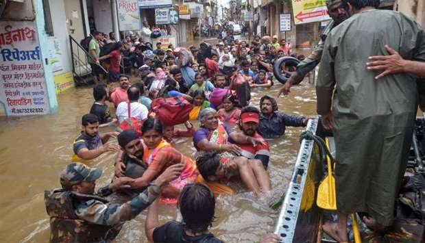 Indian Army personnel rescue people stranded in flood waters after heavy rains on the outskirts of S