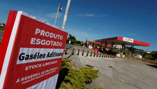 """A placard reading """"Diesel sold out"""" is seen at a gas station in Lisbon, Portugal"""