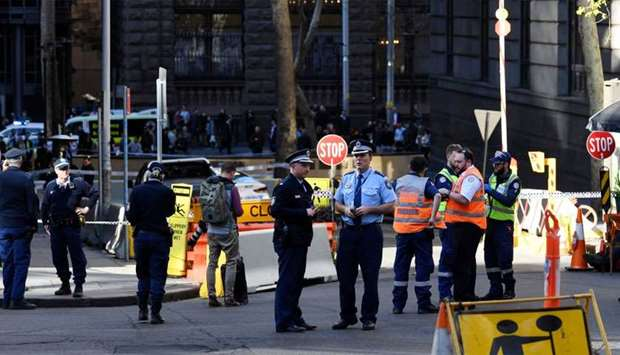 Police officers investigate near the scene of a knife rampage in Sydney