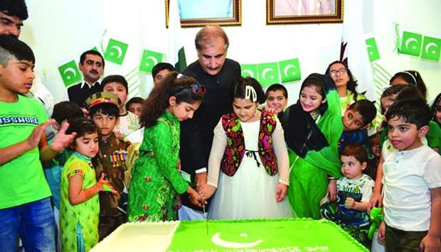 The ambassador along with children from Pakistani community cutting a cake on the occasion.