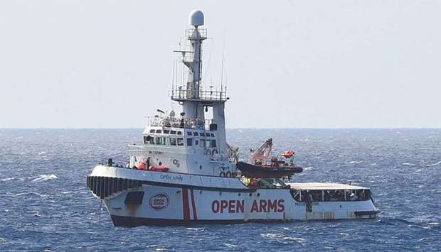 Spanish migrant rescue ship Open Arms is seen close to the Italian shore in Lampedusa