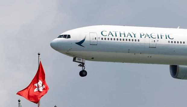 A Cathay Pacific Boeing 777-300ER plane lands at Hong Kong airport after it reopened following clash