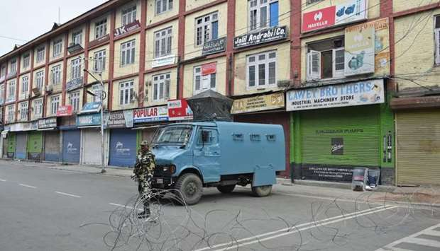 A member of the Indian security forces stands guard during a lockdown in Srinagar