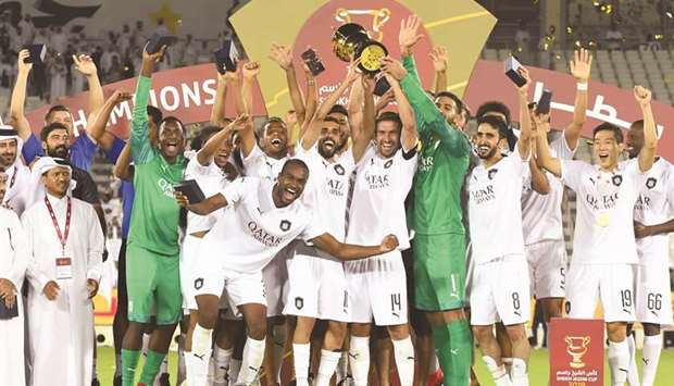 Al Sadd players lift the Sheikh Jassim Cup after their win over Al Duhail in the match at Jassim Bin