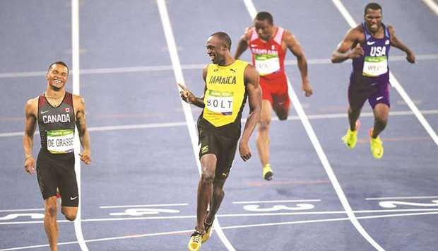 In this August 18, 2016, picture, Usain Bolt (right) of Jamaica and Canada's Andre de Grasse laugh a