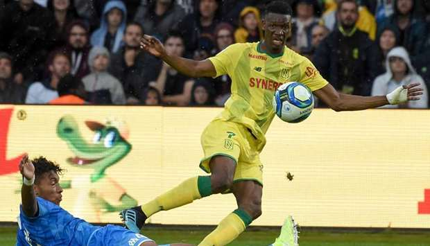 Marseille's Boubacar Kamara (left) battles for the ball with Nantes' Kalifa Coulibaly during the Fre