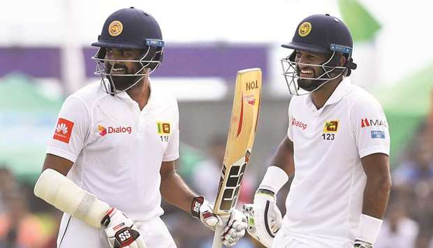 Sri Lanka Dimuth Karunaratne (right) and Lahiru Thirimanne have both scored unbeaten half centuries