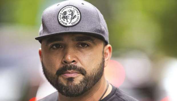 Right-wing leader Joey Gibson turned himself in to Portland city authorities on Friday.