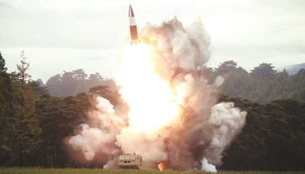 This picture released yesterday by Korean Central News Agency (KCNA) shows the test-firing of a new