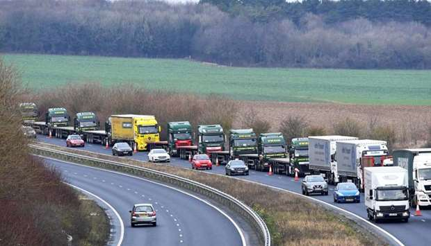 A line of lorries is seen during a trial between disused Manston Airport and the Port of Dover of ho