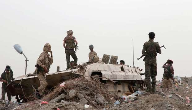 Members of southern Yemeni separatist forces stand by a military vehicle during clashes with governm