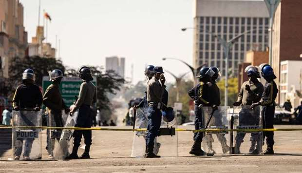 Police officers patrol near Tredgold Magistrates courts in Zimbabwe