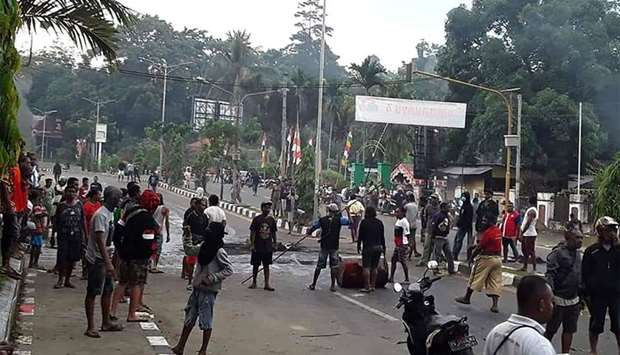 Protesters take to the street to face off with Indonesian police in Manokwari, Papua