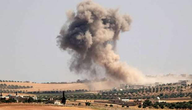 Smoke billows during pro-regime bombardments in the area of Maar Hitat in Syria's northern Idlib pro
