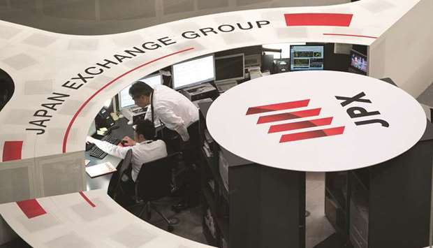 Employees work at the Tokyo Stock Exchange. The Nikkei 225 closed down 0.3% to 20,618.57 points yest
