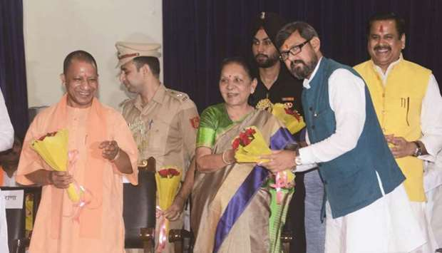 Uttar Pradesh Governor Anandiben Patel congratulates one of the newly-sworn in ministers in Lucknow