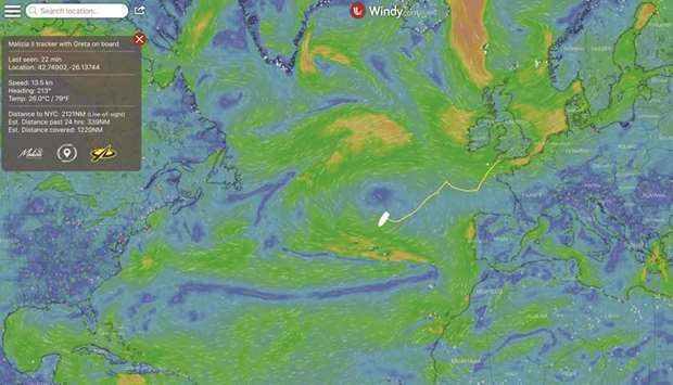 A digital map shows Greta Thunberg's journey across the Atlantic in Malizia II and the surrounding w