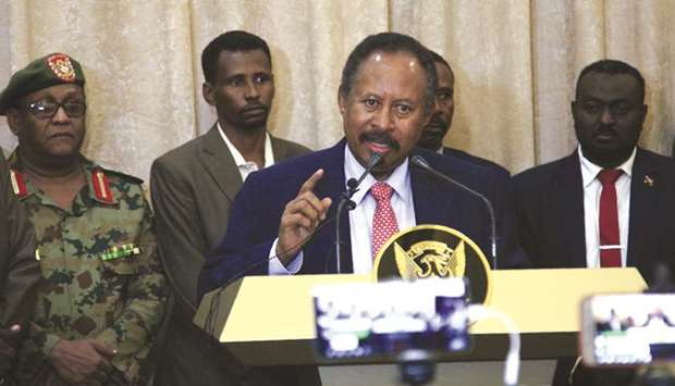 Abdallah Hamdok, speaks after being sworn in as Sudan's interim prime minister in the capital Kharto