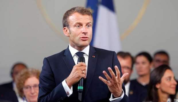 French President Emmanuel Macron delivers a speech on the eve of the G7 summit