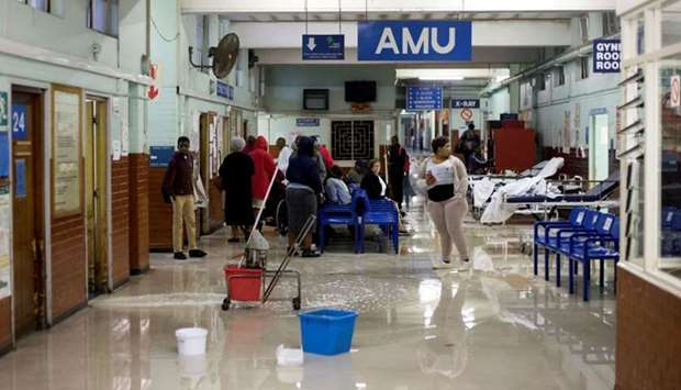 Cleaners mop up water at King Edward VIII Hospital during a storm in Durban
