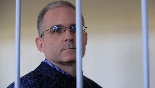 Former US Marine Paul Whelan, who was detained and accused of espionage, looks out of a defendants'