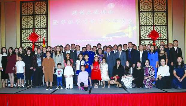 Ambassador Zhou Jian with a group of Chinese expatriates at the event in Doha yesterday. PICTURE: Ja