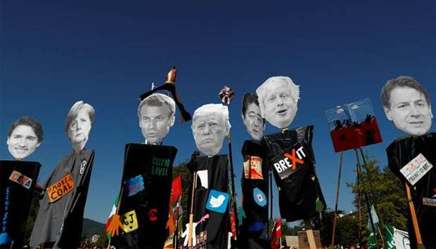 Cutout of the heads of the G7 leaders are pictured ahead of the protest march during the G7 summit,